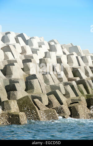 Concrete forms interlocked to make a sea wall breakwater. - Stock Photo