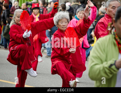 Vancouver, British Columbia, Canada. 22nd February, 2015. Colorfully-dressed women perform with fans in the Chinese - Stock Photo