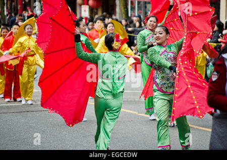 Traditional fan dancers perform in the Chinese New Year's Parade in Vancouver's Chinatown.  The 2015 New Year's - Stock Photo