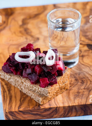Rye bread with beetroot salad and shot of vodka, selective focus - Stock Photo