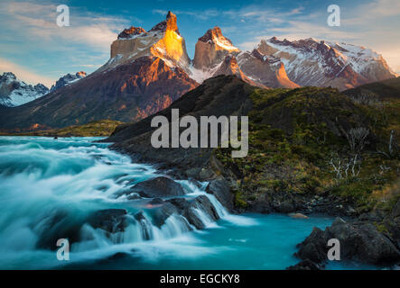 Los Cuernos towering above Salto Grande and Lago Nordenskjold, Torres del Paine, Chilean Patagonia - Stock Photo
