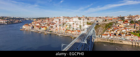 View of the iconic Dom Luis I bridge crossing the Douro River, and the historical Ribeira and Se District in the - Stock Photo