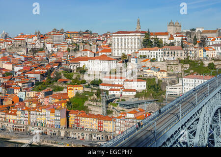 Porto, Portugal. View of the iconic Dom Luis I bridge that crosses the Douro River, and the historical Ribeira and - Stock Photo