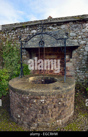 Wishing Well in Memorial Garden, St George Priory Church, Dunster, Somerset - Stock Photo