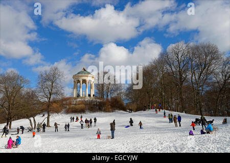 Sledging in front of the Monopteros, English Garden, Munich, Upper Bavaria, Bavaria, Germany - Stock Photo