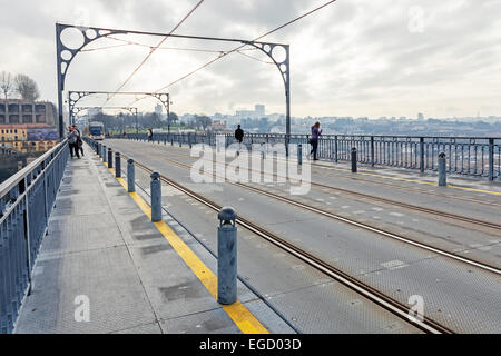 Subway railway tracks and electric cables on the superior deck of the Dom Luis I bridge connecting Vila Nova de - Stock Photo