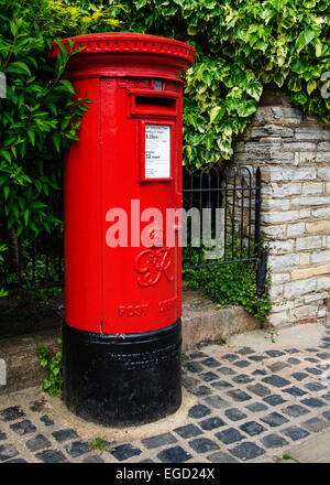 Typical red post box in England, UK - Stock Photo
