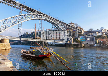 The iconic Rabelo Boats, the traditional Port Wine transports, with the Ribeira District and the Dom Luis I Bridge - Stock Photo