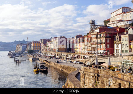 Porto, Portugal. The historical Ribeira District and the Rabelo boats at sunset. Unesco World Heritage. - Stock Photo