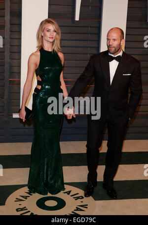 Los Angeles, California, USA. 23rd Feb, 2015. ROSIE HUNTINGTON-WHITELEY, JASON STATHAM  MODEL AND ACTOR  VANITY - Stock Photo