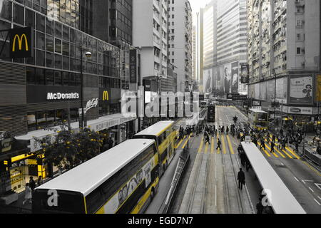 Busy Pedestrian crossing in central Hong Kong - Stock Photo