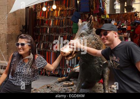 Tourists at Il Porcellino, skulpture of a wild pig, Loggia des Mercato Nuovo, historic centre of Florence, UNESCO - Stock Photo