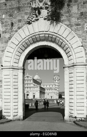 Cathedral with the leaning tower seen through the gates, Torre pendente, leaning tower, Piazza dei Miracoli, Piazza - Stock Photo