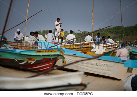 Fishermen at beach, Arugam Bay, Ampara District, Sri Lanka - Stock Photo