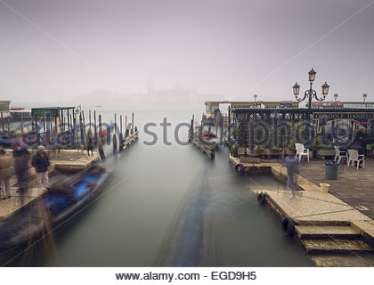 Gondolas and Taxi Pier in front of Piazza San Marco with San Giorgio Maggiore in the background, Venice, Italy - Stock Photo
