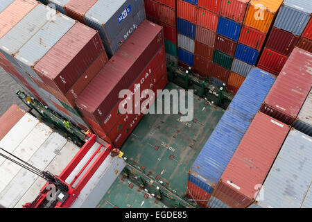 Container being loaded onto a ship, Hamburg, Germany - Stock Photo