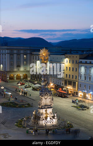 Main square in the evening with the baroque Holy Trinity column, also known as Plague column, Linz, Upper Austria, - Stock Photo