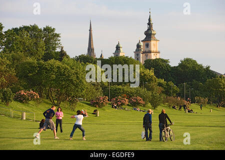 The flood zone of the Danube is normally a green park. Steeples of the new cathedral, Mary-Immaculate-Conception - Stock Photo