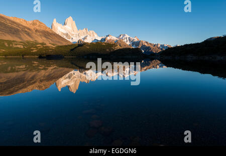Sunrise over the Fitz Roy Mountain Range, Laguna Capri, Los Glaciares National Park, Santa Cruz Province, Argentina - Stock Photo