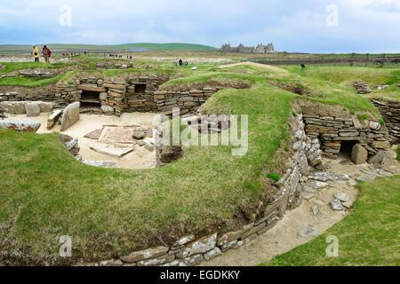 Tourists visiting the Neolithic settlement Skara Brae, Skara Brae, UNESCO World Heritage Site The Heart of Neolithic - Stock Photo