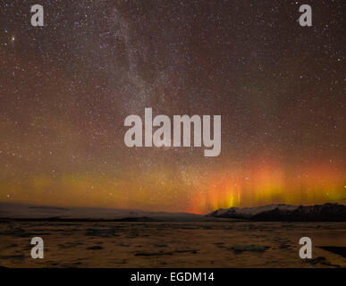 Aurora borealis or Northern Lights and Milky Way galaxy Jokulsarlon Iceland Europe - Stock Photo