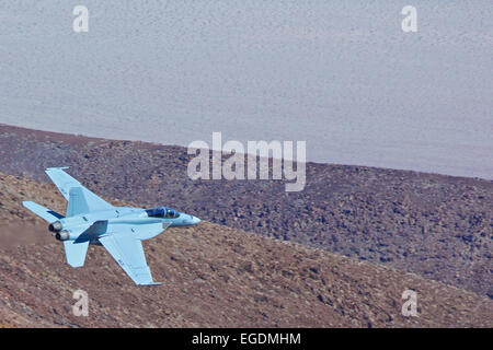Topside View Of A US Navy F/A-18E Super Hornet Jet Fighter, Flying At Low Level Into Death Valley. - Stock Photo