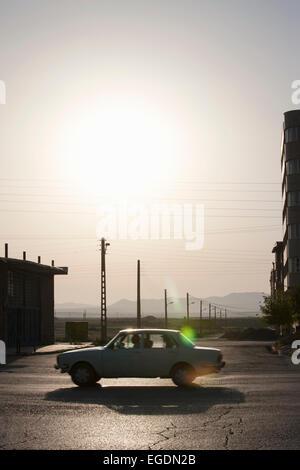 Car on main road silhouetted, Bazargan, Maku County, West Azerbaijan District, Iran - Stock Photo