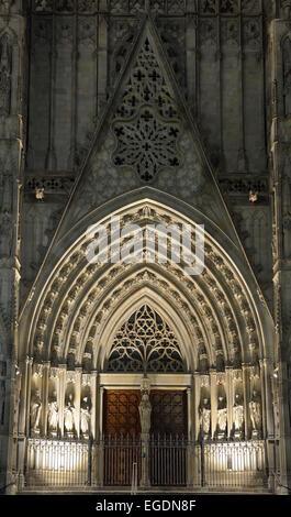 Illuminated portal of Barcelona cathedral, La Catedral de la Santa Creu i Santa Eulalia, Gothic architecture, Barri - Stock Photo