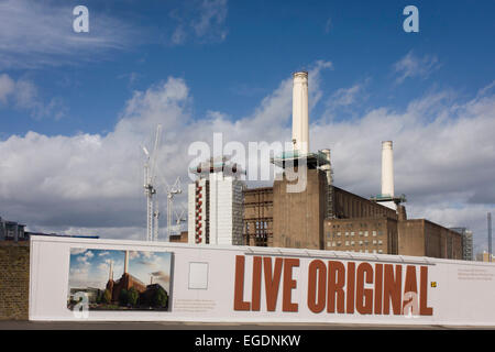 Battersea power station (with its 4th chimney removed for renovation) where future exclusive housing will be built - Stock Photo