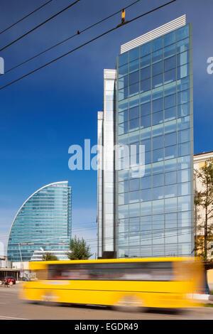 Bus on Chinggis Avenue passing Blue Sky Tower, Ulaanbaatar, Mongolia - Stock Photo