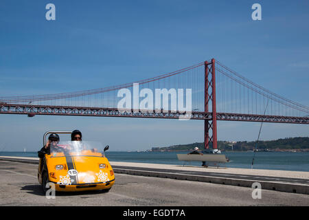 GoCar on the seafront promenade near Ponte 25 de Abril bridge over Tagus river, Lisbon, Lisboa, Portugal - Stock Photo