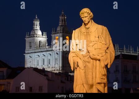 Statue of Sao Vicente near Miradouro de Santa Luzia in Alfama district at night, Lisbon, Lisboa, Portugal - Stock Photo