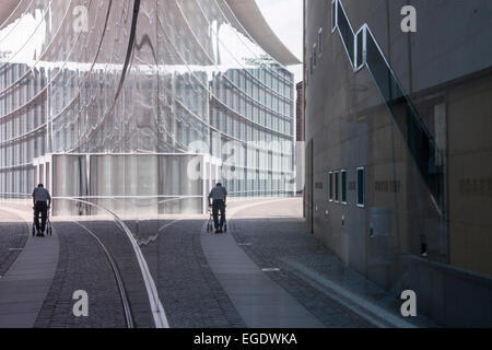 Reflection of man with walker in the window of the museum of modern art, Neues Museum, Nuremberg, Franconia, Bavaria, - Stock Photo