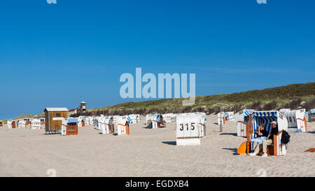 Beach chairs on the beach with dunes in the background, Spiekeroog Island, North Sea, East Frisian Islands, East - Stock Photo