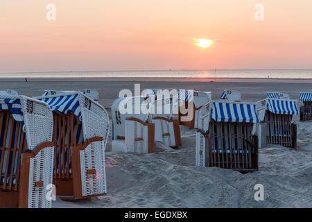 Beach chairs on the beach at sunset, Spiekeroog Island, North Sea, East Frisian Islands, East Frisia, Lower Saxony, - Stock Photo