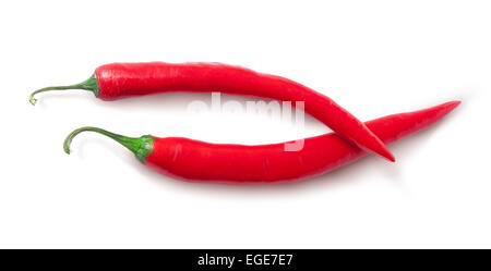 Two red chili peppers crossed isolated on white background - Stock Photo
