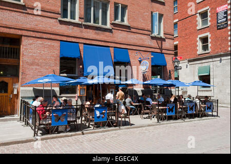 People eating on a terrace, Old Montreal, province of Quebec, Canada. - Stock Photo