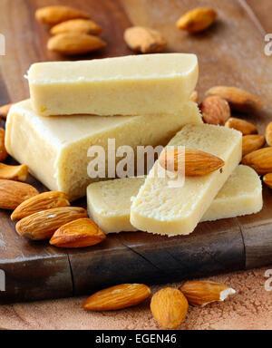 Marzipan almonds bar bread, wish fresh almond on a wooden board - Stock Photo