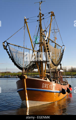 Shrimp boat in the harbour of Greetsiel, North Sea, East Frisia, Lower Saxony, Germany - Stock Photo