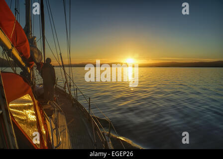 Scenic sunrise viewed from yacht over the coast of Chile in South America - Stock Photo