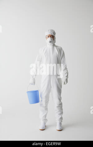 Young Japanese man in a protective suit - Stock Photo