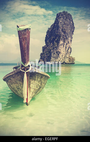 Retro vintage filtered picture of a wooden boat on beach. - Stock Photo