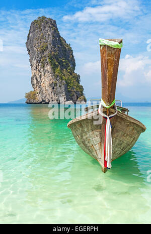 Old wooden boat on a tropical island. - Stock Photo