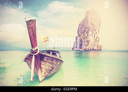 Vintage filtered picture of wooden boat on a tropical island. - Stock Photo