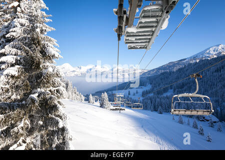 View down the valley from a chair lift in Les Gets ski resort, Portes Du Soleil, France - Stock Photo