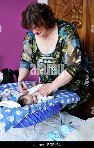 The home visit midwife wins for prevention and care for the birth of a child is becoming increasingly important. - Stock Photo