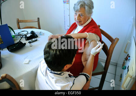 The elderly and sick visit to the doctor's assistant relieves the practice owner of routine tasks such as taking - Stock Photo
