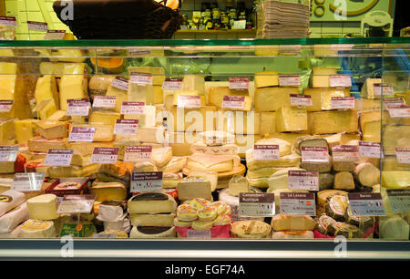 Different cheeses on display at cheese store, San Anton covered Market, Madrid, Spain. - Stock Photo
