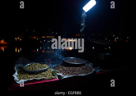 A popular street food in Rishikesh, India. This stall sold roasted nuts on a small street next to the Ganges. - Stock Photo