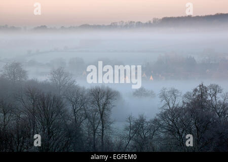 Winter view of Lower Swell village in dawn frost and fog, Stow-on-the-Wold, Cotswolds, Gloucestershire, England, - Stock Photo